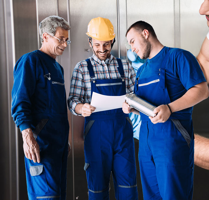 Blue-collar workers inspecting a plan